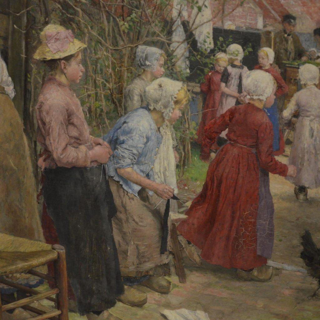 Junge Mädchen in Kleidern mit Haube und Strickstrumpf